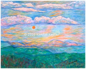 Green mountains with pink and orange sunrise