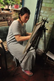 Woman working at an easel
