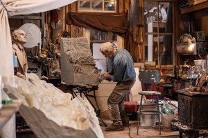 Sculptor at work in studio