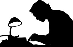 silhouette of writer working at a typewriter