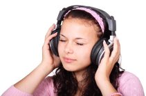 Girl with headphones listening