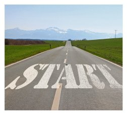 Road extending to the distance with the word start at the beginning